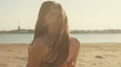 Freedom and happiness concept, young woman on beach shaking her head with long Stock Footage