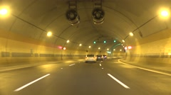 Cars in tunnel go on road according to traffic rules Stock Footage