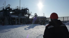 Man is going to station at oil depot - stock footage