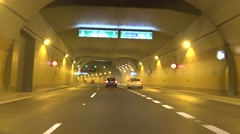 Cars go on road and departure from tunnel Stock Footage