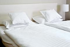 Double bed in hotel room. Accommodation. - stock photo