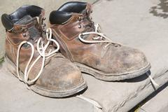 Worn boots Stock Photos