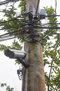 Surveillance camera on a pole Stock Photos