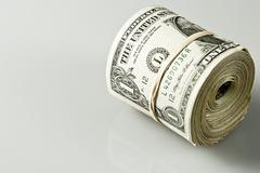 Rolled up banknotes - stock photo