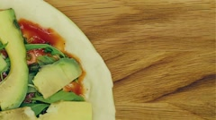 Vegetarian pizza rotating  on the wooden background loop able close up Stock Footage