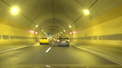 Timelapse cars go on road and in tunnel at night in city Stock Footage