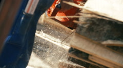 Cutting through wood with chainsaw in slow motion. Stock Footage