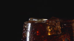 SLOW: A cola drink in glass with ice Stock Footage