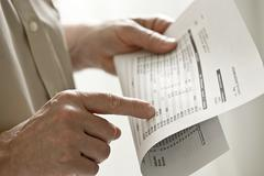 A man holding a bank statement Stock Photos