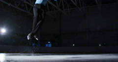 Children figure skating on ice slow motion Stock Footage
