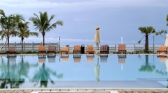 View to the empty hotel swimming pool at sunrise in Trincomalee, Sri Lanka. Stock Footage