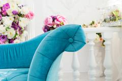 turquoise sofa in luxury apartments with flowers - stock photo