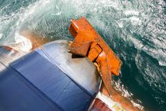 Rusty anchor of a cargo ship Stock Photos