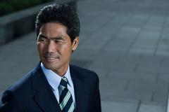 Japanese businessman on a sidewalk Stock Photos