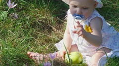 Eight month girl with flower and apple Stock Footage