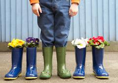 Boy wearing frog wellies Stock Photos