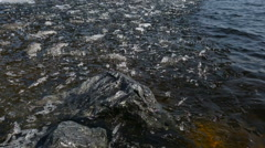 Ice chips floating in clean spring river Stock Footage