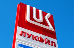 The emblem of the oil company Lukoil against the blue sky background Stock Photos