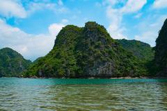 Mountain islands in Halong Bay - stock photo