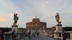 Tourist visit Castel Sant'angelo bridge and Berninis statue - stock footage