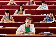 Students in lecture theatre - stock photo
