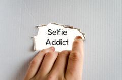 Selfie addict text concept Stock Photos