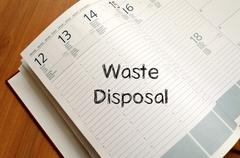 Waste disposal write on notebook Stock Photos