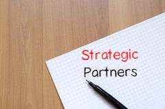 Strategic partners write on notebook Stock Photos