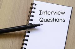 Interview questions write on notebook - stock photo