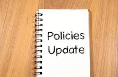 Policies update text concept Stock Photos