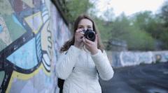 girl - photographer adjusts the digital SLR camera - stock footage