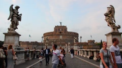 Tourist visit Castel Sant'angelo bridge and Berninis statue Stock Footage