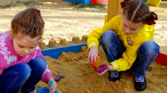 Children playing in the sandbox Stock Footage