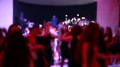 Group of blurred people dancing in a dark banquet hall for a wedding reception Stock Footage
