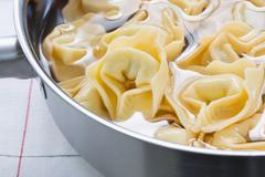 Pasta in a saucepan Stock Photos