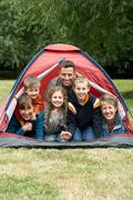 Family in a tent Stock Photos