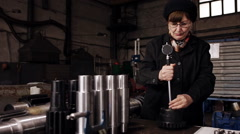 woman inspector checks the item on compliance with technical standards - stock footage