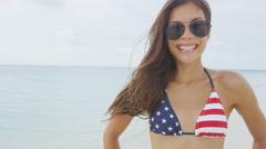 Happy American bikini girl smiling on USA beach travel holiday - stock footage