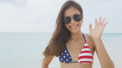 American Asian woman waving with USA flag bikini Stock Footage