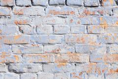 Aged colourful brick wall background - stock photo
