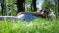 Beauty Girl lying on the Meadow with green grass Stock Footage