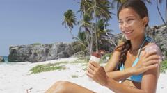 Sunscreen beach vacation Asian woman applying suntan lotion on summer holidays Stock Footage