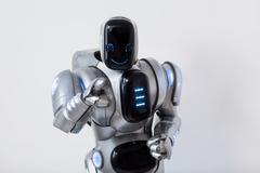 Smiling robot pointing you Stock Photos