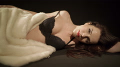 Fashion elegant woman in black lingerie covered with white fur coat Stock Footage