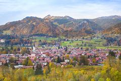 Beautiful little village with a traditional church in the Alps mountains Stock Photos