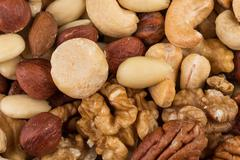 Lot of different types of nuts Stock Photos
