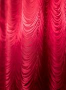 Red fabric curtain as a backdrop. Stock Photos