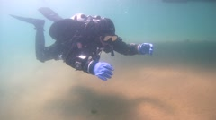 Tech diver hovered over a sandy bottom Stock Footage