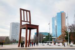 Broken Chair monument near United Nations palace in Geneva Stock Photos