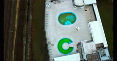 Aerial view of two empty swimming pools on the roof Stock Footage